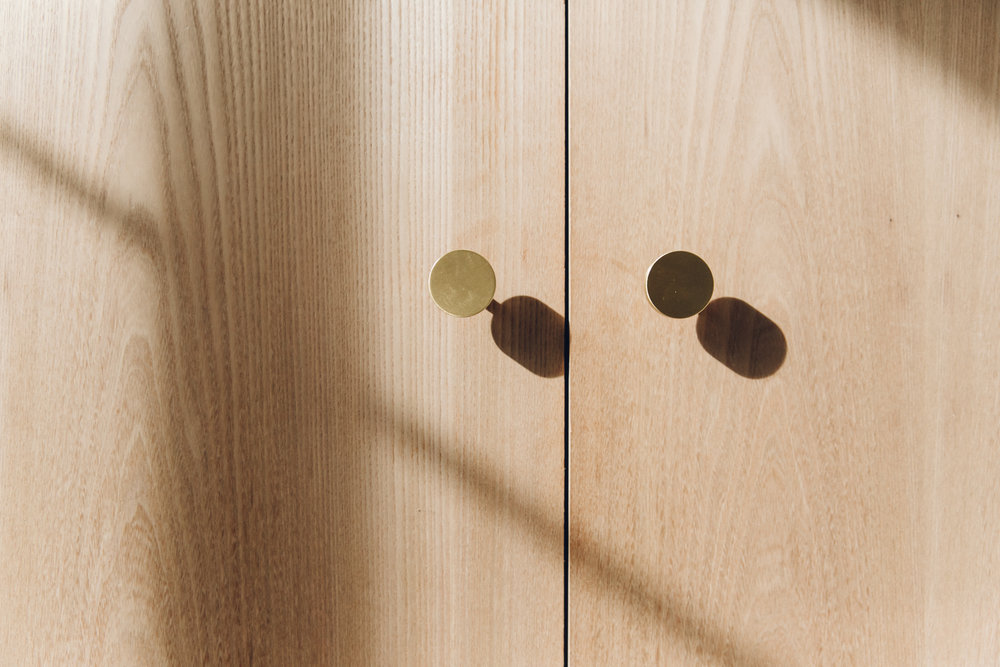 Midcentury-inspired brass design details by Bentley Hagen Hall.