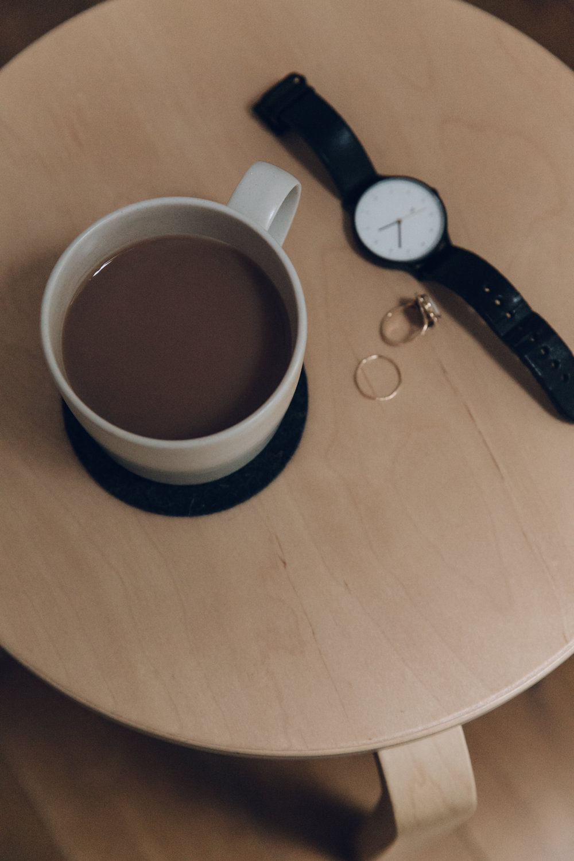 Bedside details with a Habitat mug.