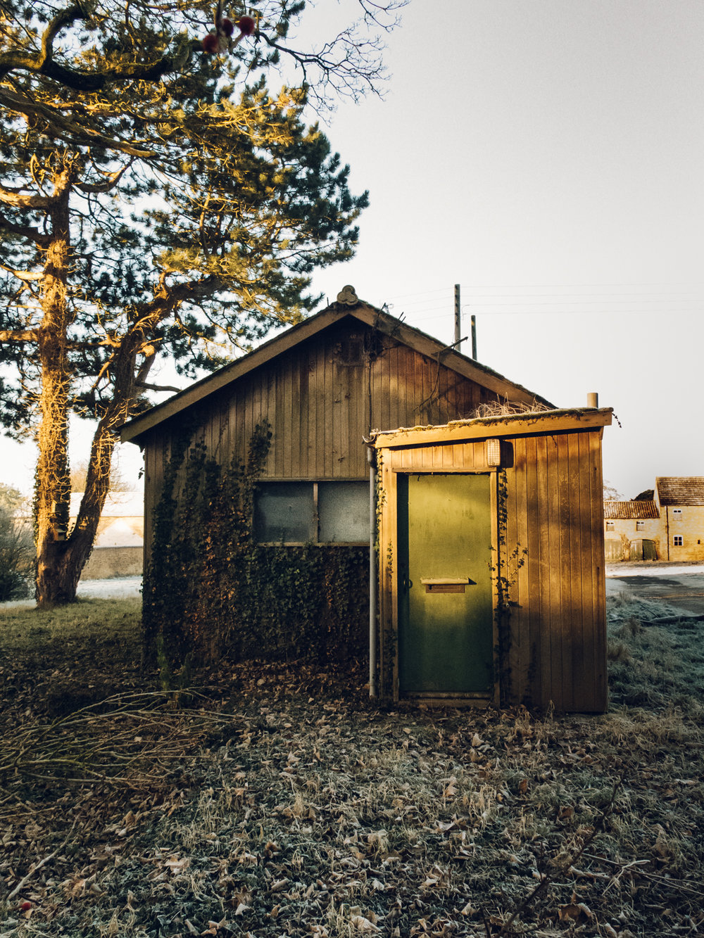 Tired old charming wooden shed.