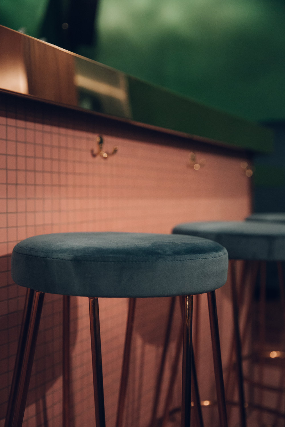 Pink and green interior at Public, a bar in Sheffield