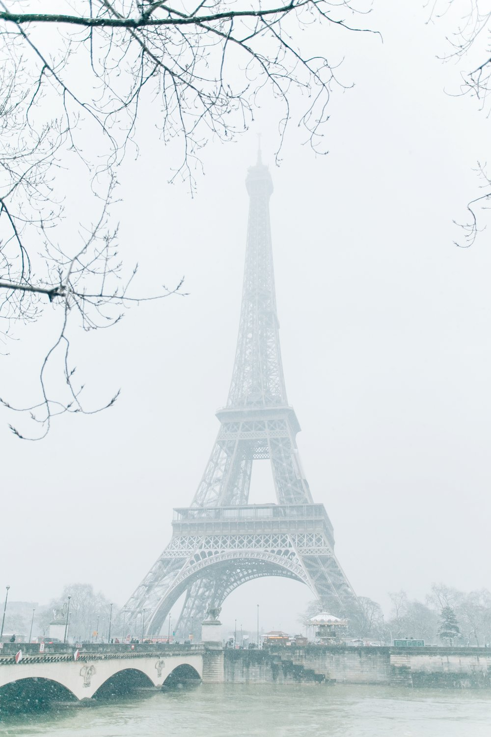 Paris in the Winter by Haarkon. The Eiffel Tower in the snow.
