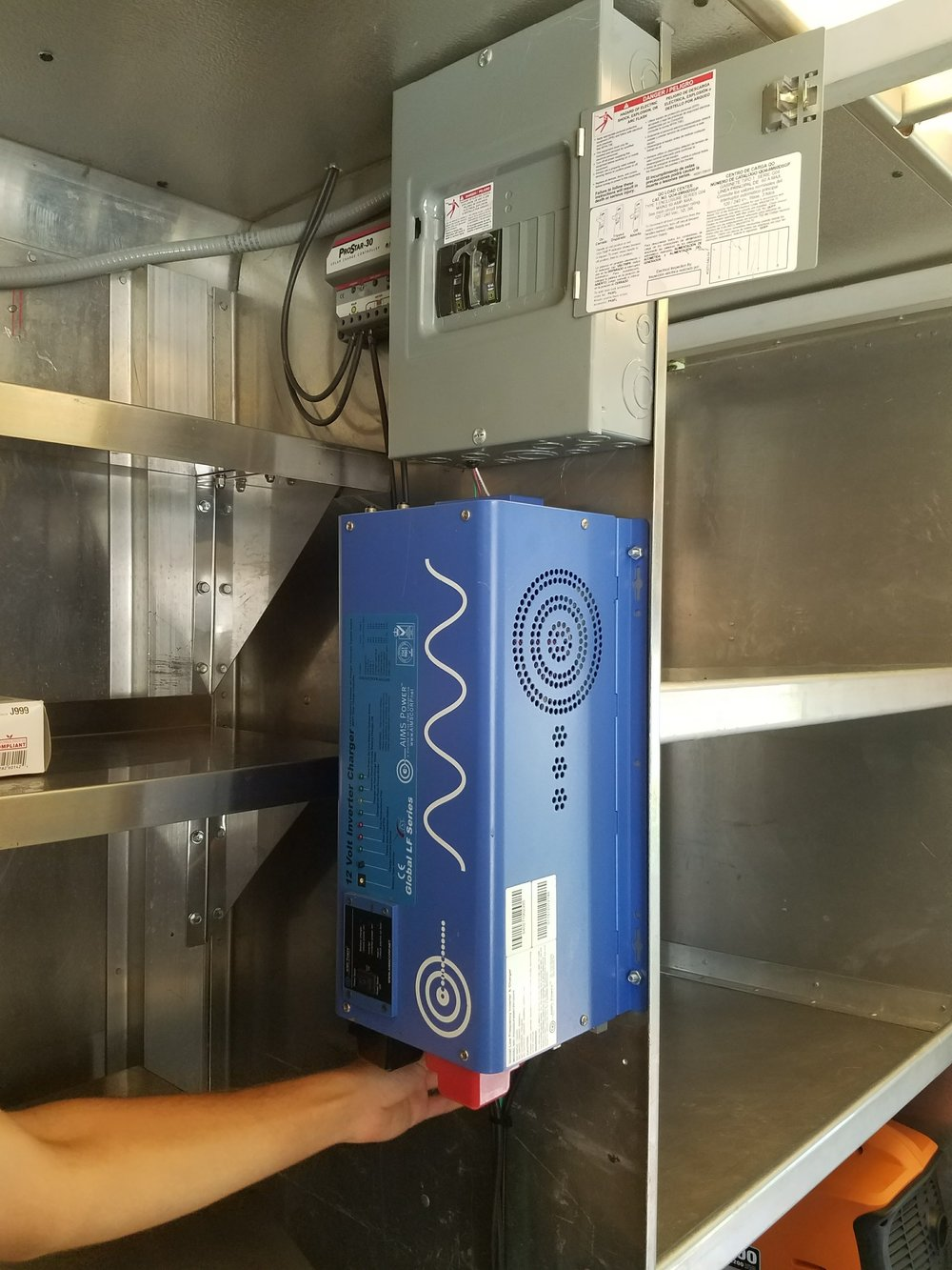 The inverter, converting the energy to be ready-to-use by the lights, conveyor belts, fans, and other electrical appliances in the truck - photo by Olivia Foster