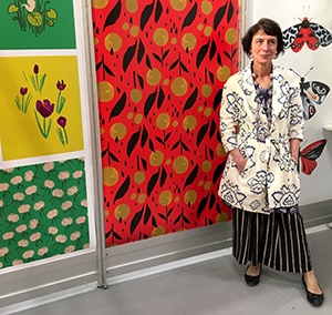 Painter and textile designer Sarah Charlton Frank at Misha Zadeh's booth at Surtex 2017