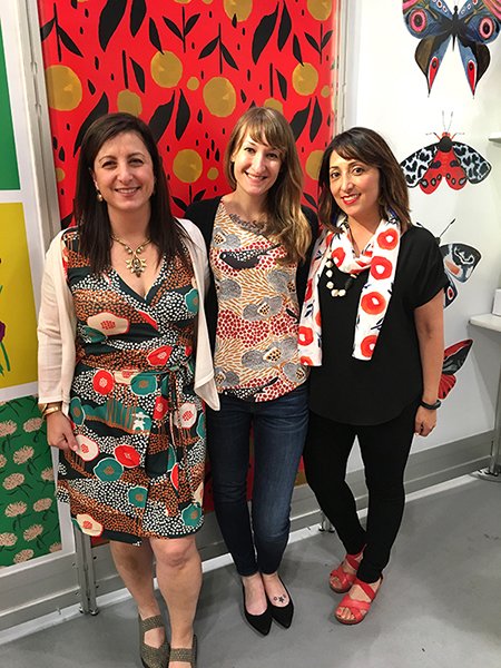 Spoonflower representatives Allison Sloan Polish and Tara Reed with designer Misha Zadeh at Surtex 2017