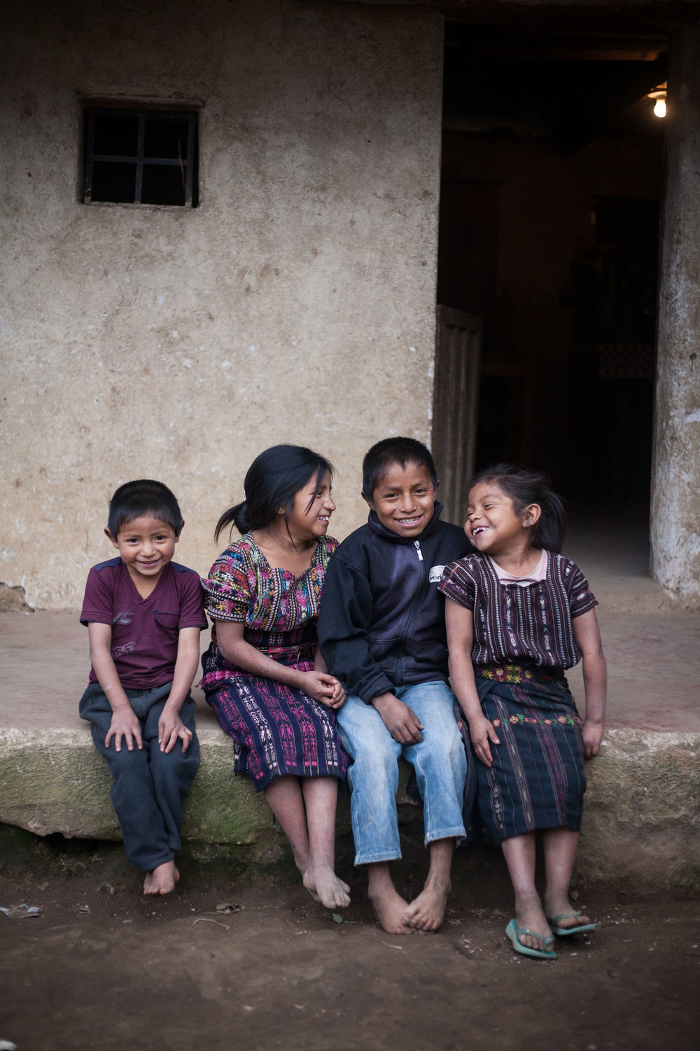 Mayra and her siblings outside their home in El Barranco, Guatemala. Photo for Mayan Families, Community Development Program.