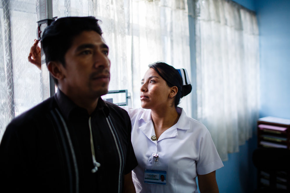 A nurse performing an HIV/AIDS consultation in a hospital in Quetzaltenango, Guatemala. Photo for Intrahealth International/USAID.