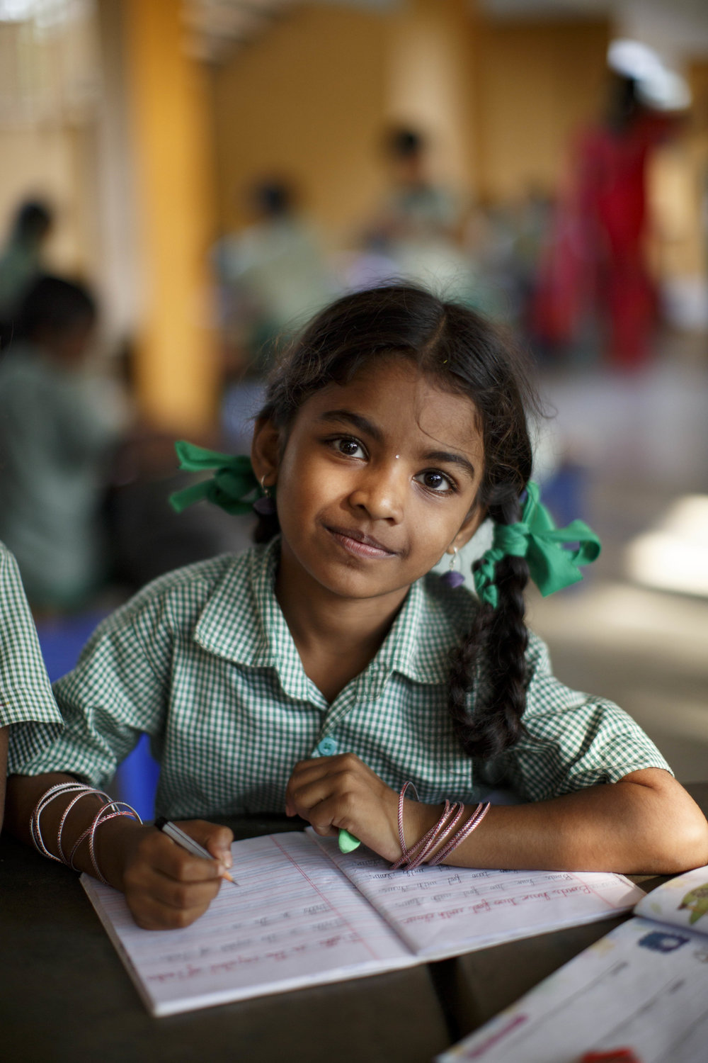 A girl from a local village receives tutoring support at Aikiyam school, which provides an innovative-educational model for village students from rural Tamil Nadu.