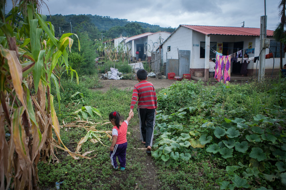 Siblings walk home in the community of Chukmuk, Guatemala, displaced by natural disaster and still suffering from many of the adverse effects of displacement.