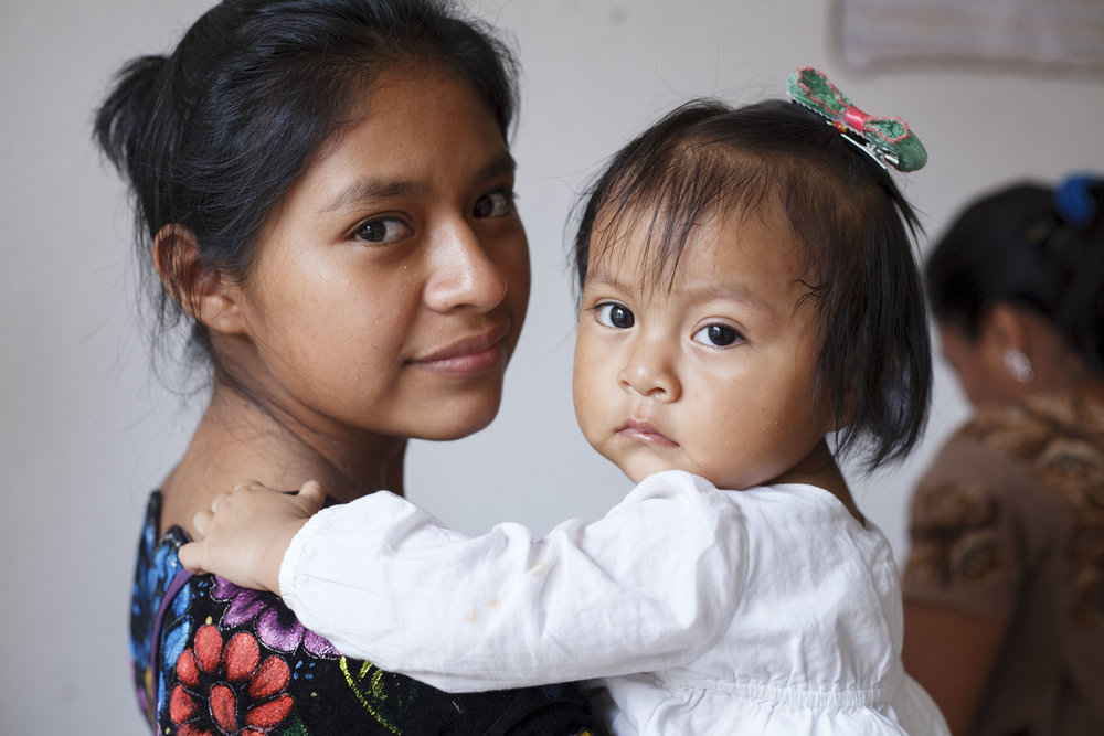 Mother and child attend a monthly check-up and educational talk for children identified as high-risk for malnutrition and undernutrition in Sololá, Guatemala.