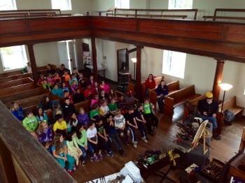 Local students gather at Mt. Zion Church for one of the many Mosby Heritage Area Association programs held throughout the region each year. Top: Willowcroft Winery, one of Loudoun County's first vineyards.