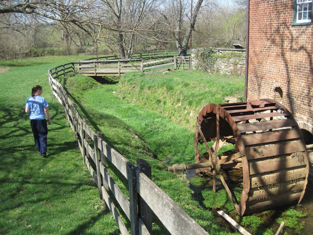 Beth Lewis explores the preserved mill near Catoctin Creek in historic Waterford, Loudoun County.