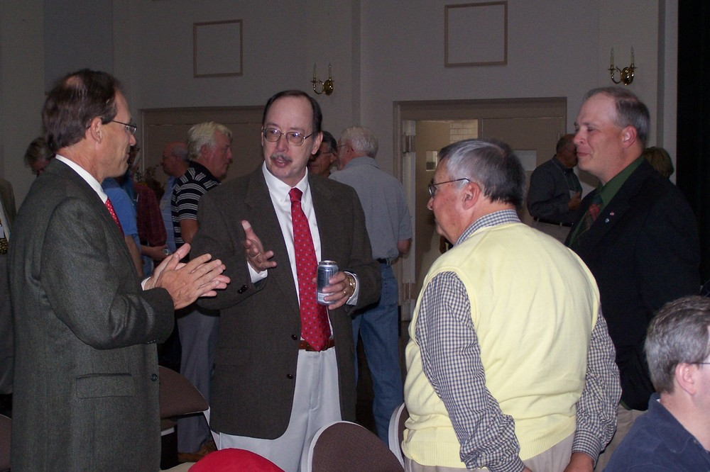 Conference attendees question historian Bob Krick during a break in the action.