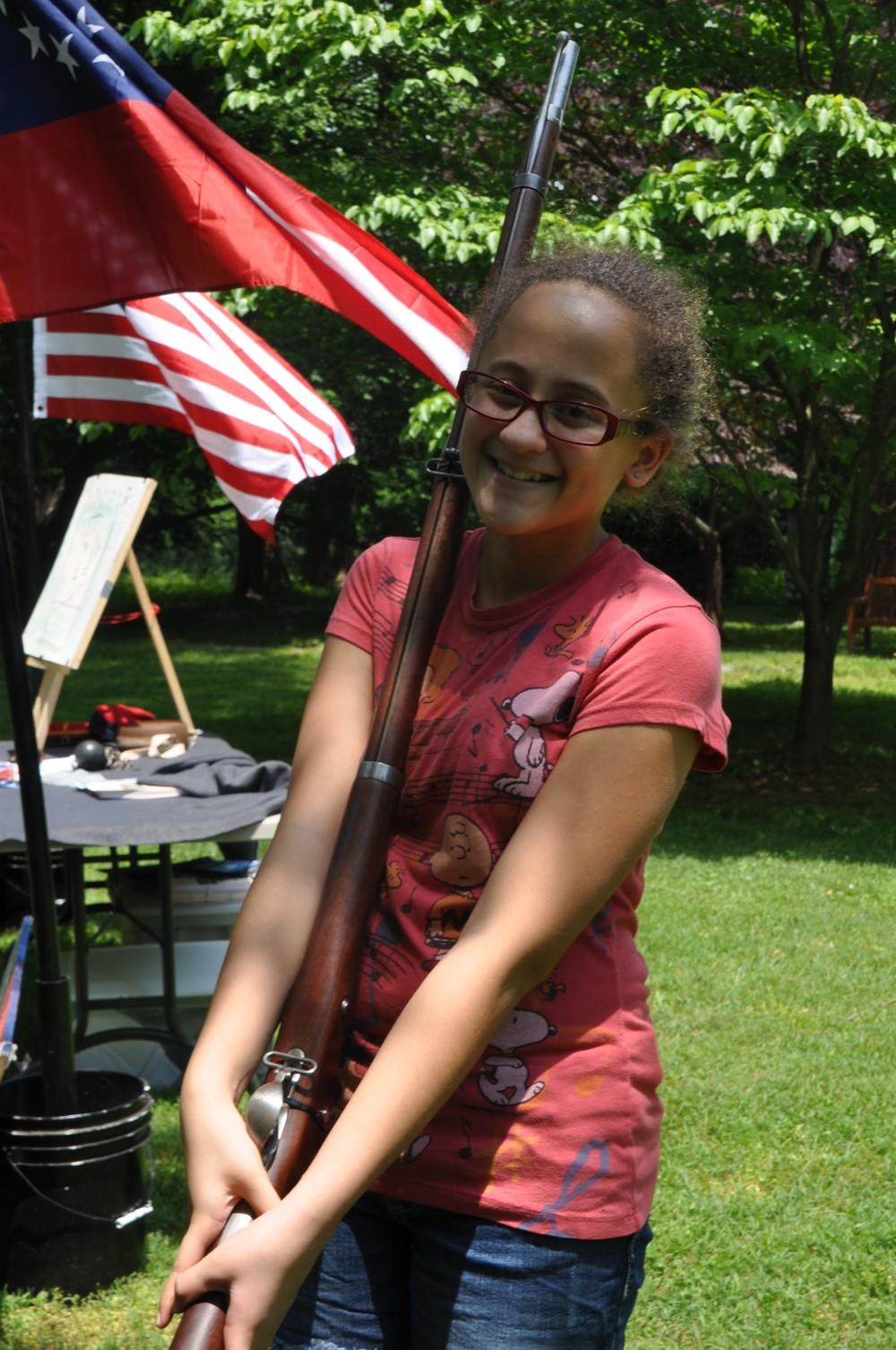 Girl camper holding musket.JPG