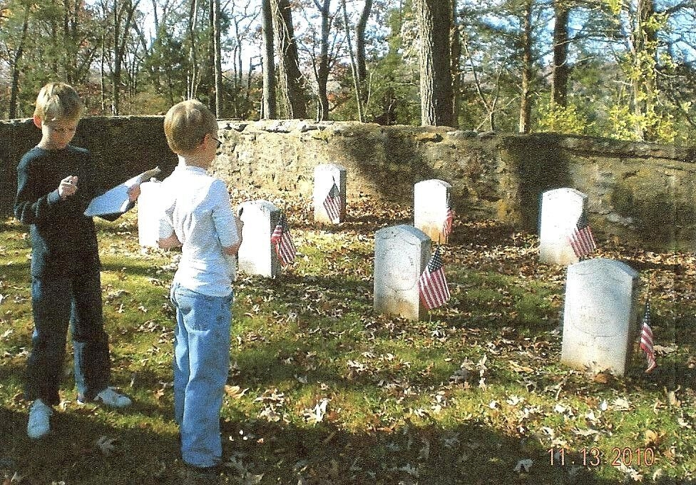 Scavenger hunters at Ball's Bluff cemetery in Loudoun County.