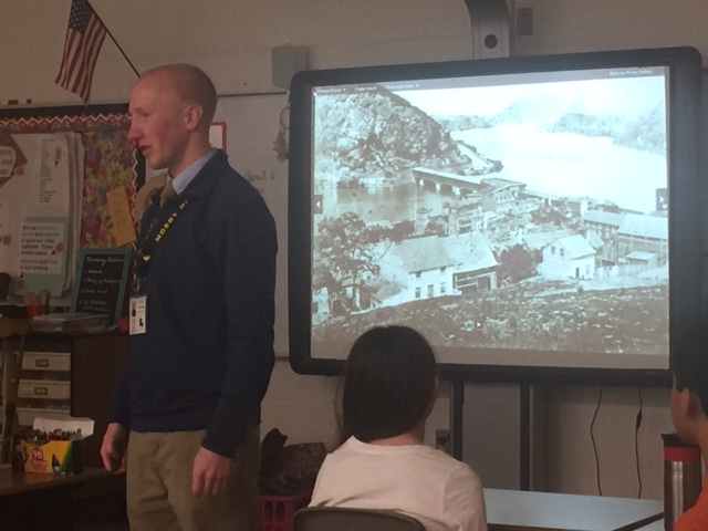 Above: Former Director of Education Kevin Pawlak speaks to Waterford Elementary students about John Brown's Raid; Top: Volunteer Joe Becek with students and their teacher at Aldie Mill.