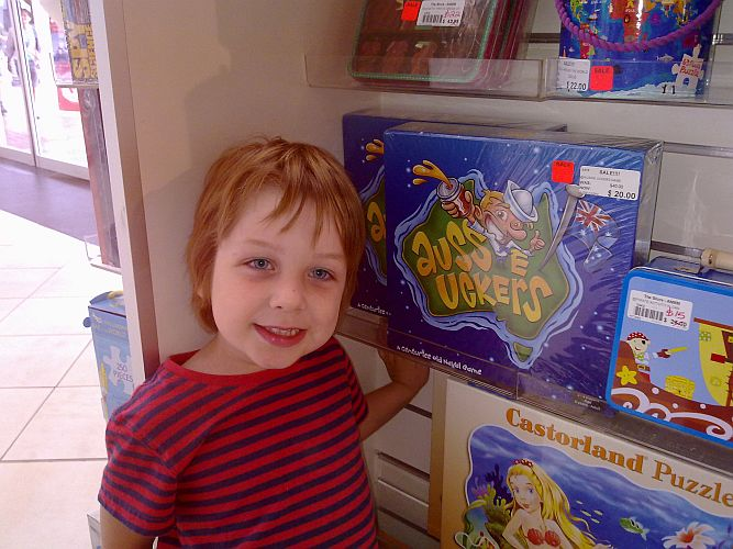 Miles Emdin with Aussie Uckers board game by Anton Emdin