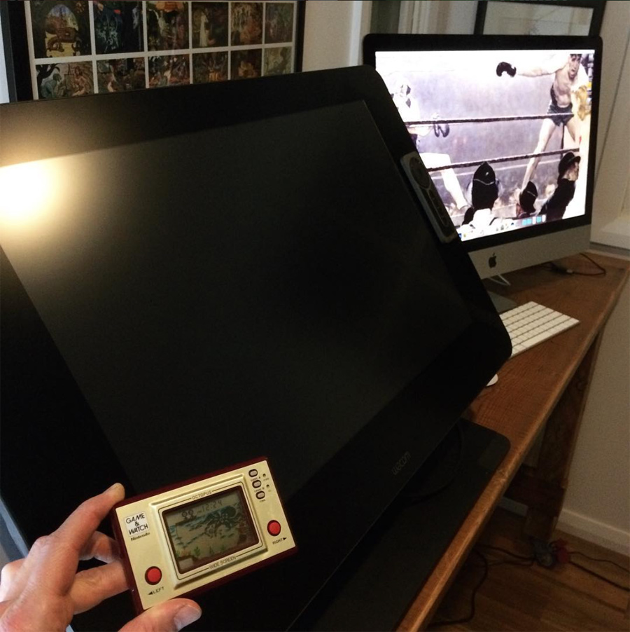 Wacom Cintiq 27QHD Touch, pictured with an old Nintendo Game & Watch, for scale