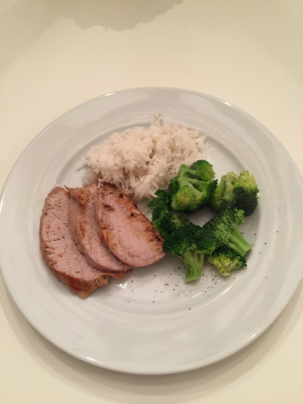 pork tenderloin with steamed broccoli and rice