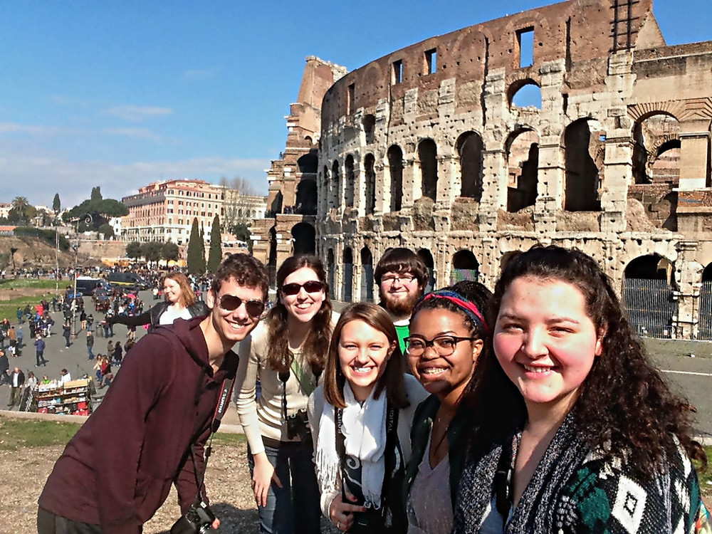 Caroline Huey and her fellow travelers in front of the COLISEUM