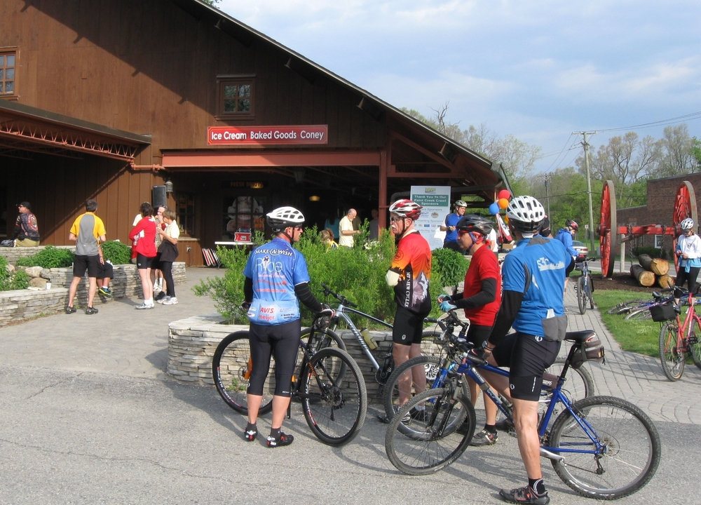 Bikers take a break at Paint Creek Cider Mill.
