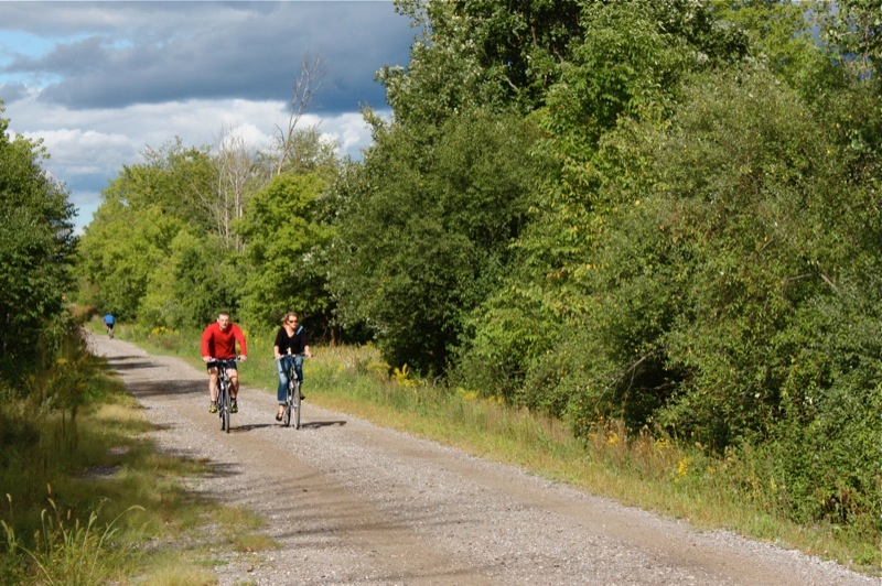 Cyclists enjoy a sunny day on clinton river trail