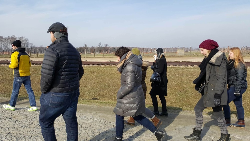 Students walk the grounds of Auschwitz