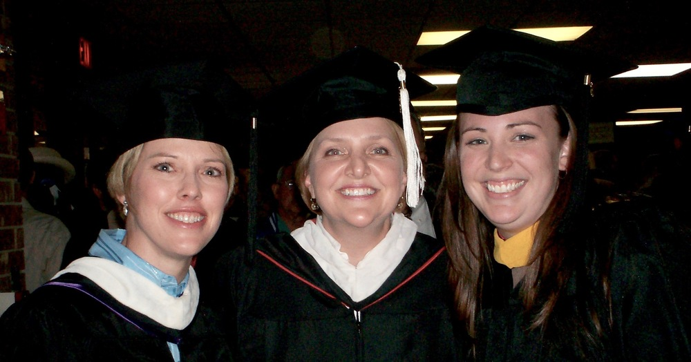 Lora Hutson, associate professor of mass communication; and Candace Cain, dean of students, celebrate Blankenship's graduation in 2006.