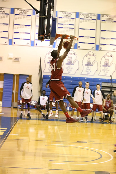 Freshman Armand Cartwright dunks in a win against Silver Lake College.