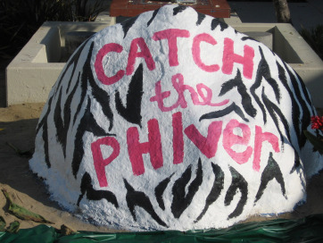 One of Pepperdine's sororities paints the campus rock.