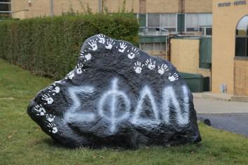 Sigma Phi Delta Nu tags the Rock during Pledge Week.
