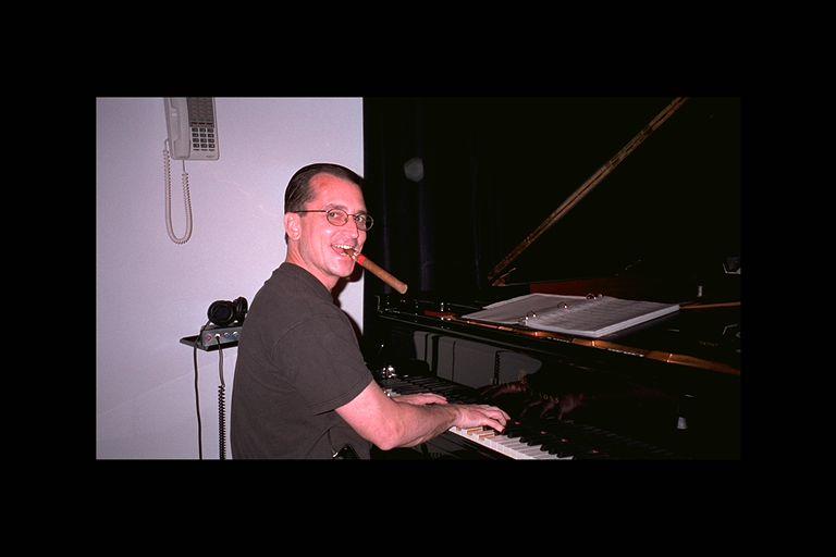 Bill Scherr Studio piano w cigar  Encompass Quartet.jpg
