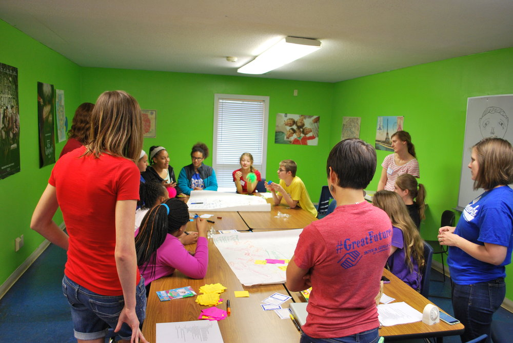 """creative workshop between ku """"design for social innovation"""" students and middle-schoolers at the boys & girls club of douglas county."""