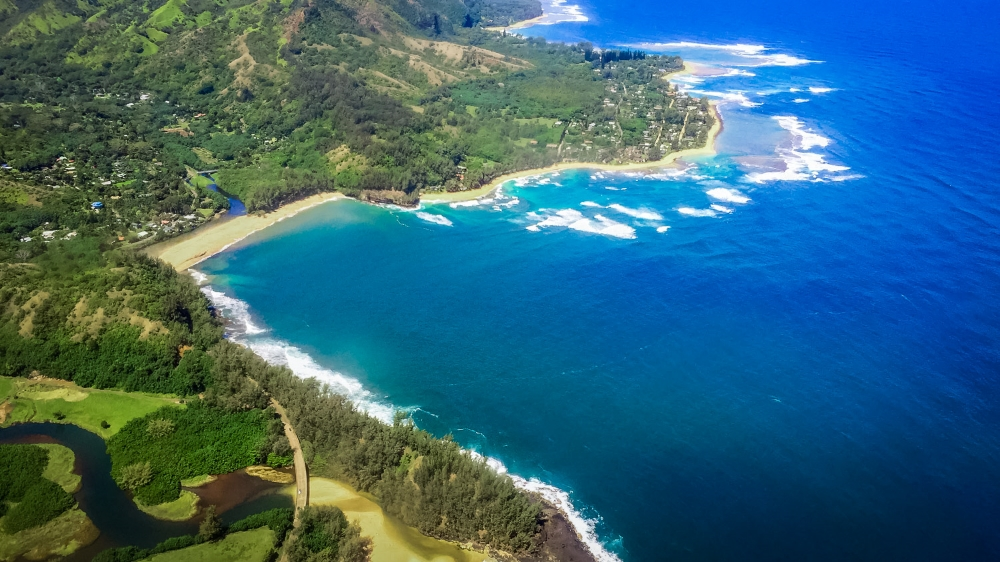 An aerial view of Kauai's coast during a helicopter tour