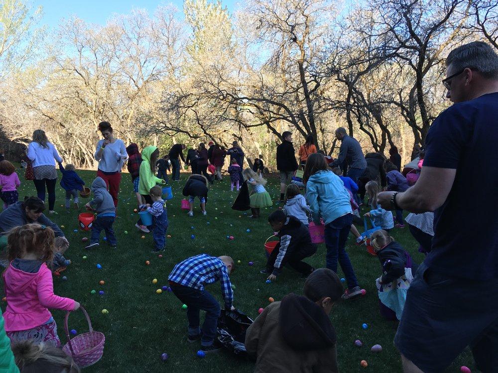 Kids having a blast at the easter egg hunt.