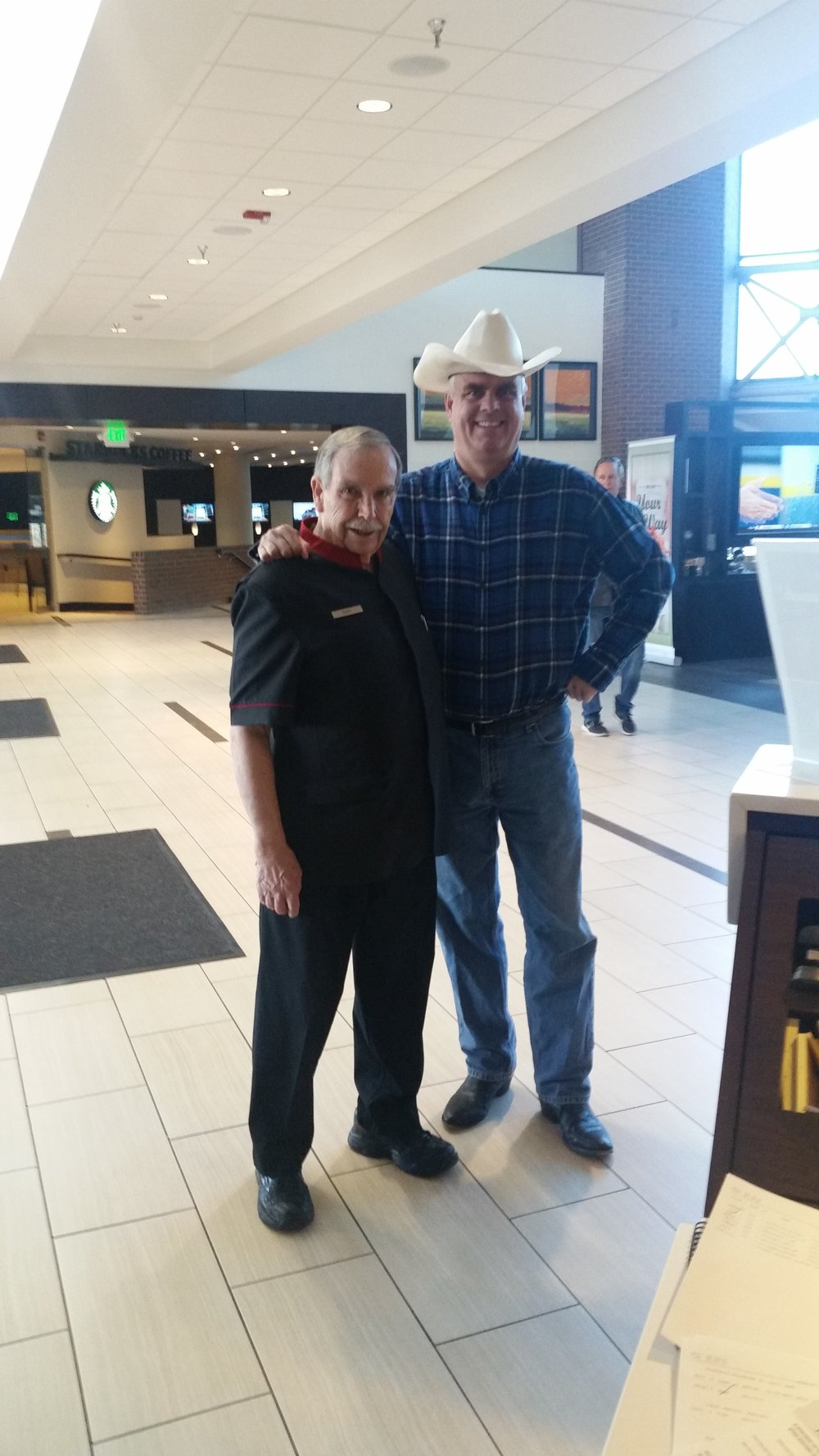 GM Steve Dennis and shuttle driver Gary posing for a picture during the down syndrome easter egg hunt.
