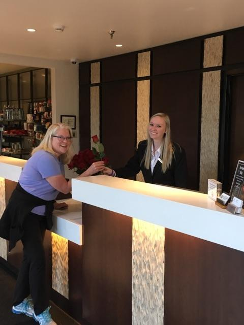 Front desk agent Hadli handing out flowers to our guest for Mother's day.