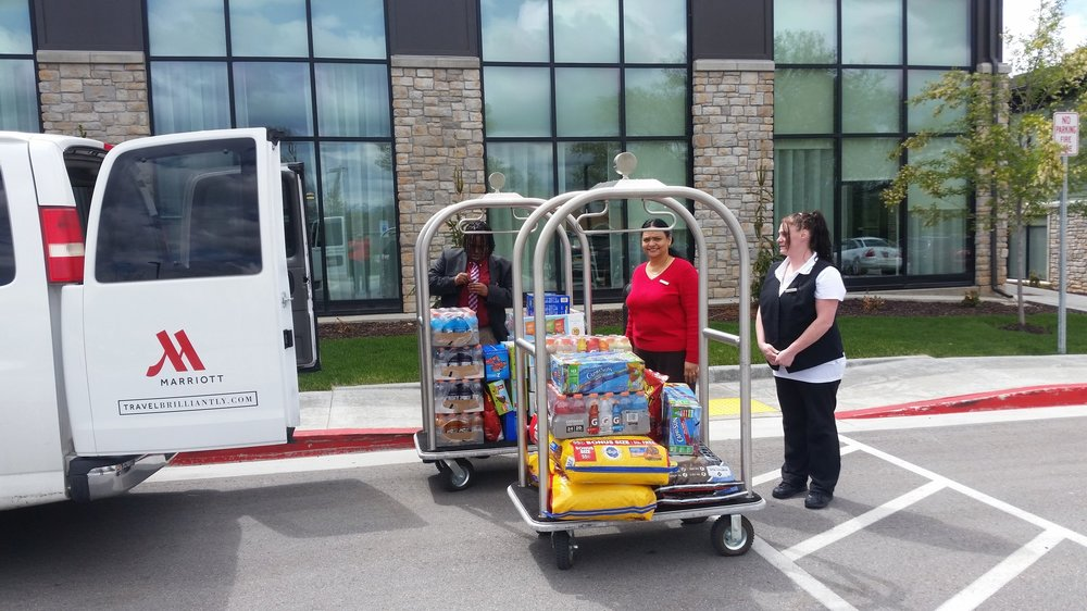 Front office manager Jericka, HR coordinator Beulah and Housekeeping supervisor Echo getting all the food loaded up to take to the wounded warrior retreat in Park City , utah.