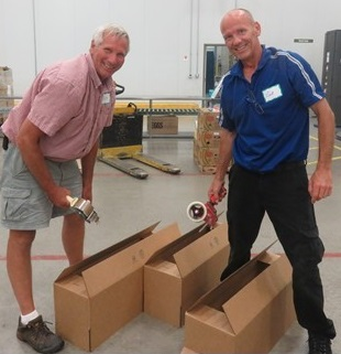 Dan Murray (Golf/Grounds Superintendent) & Nick Kolb (Chief Engineer) were pros with the boxes! Photo courtesy of the Northern IL Food Bank.