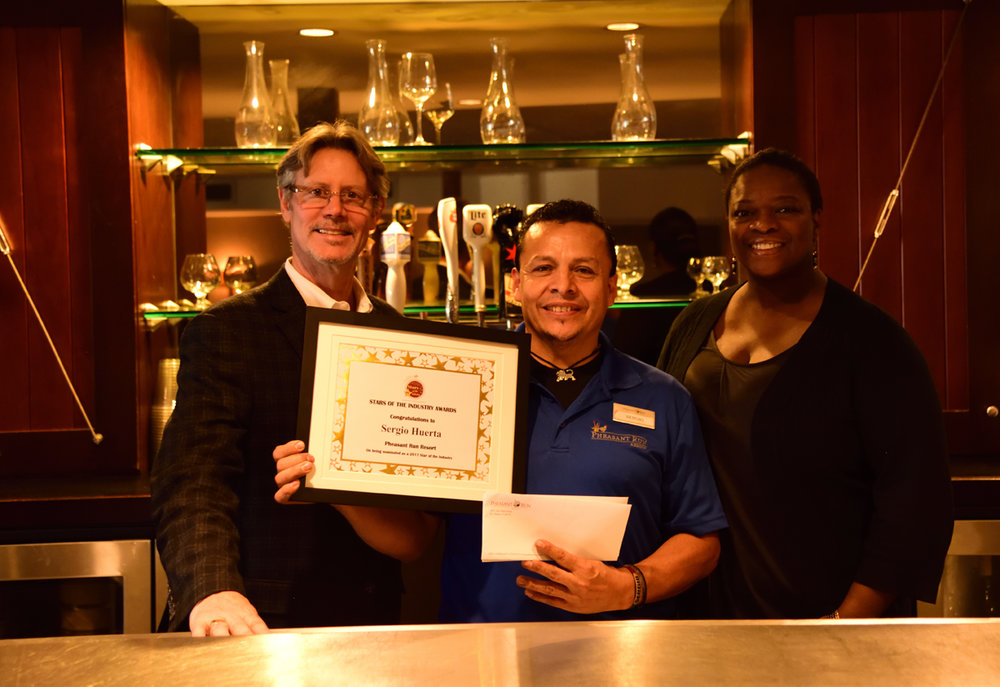 France Langan, GM and Patricia Quinn (Director of Human Resources) present Sergio with a certificate for his nomination.