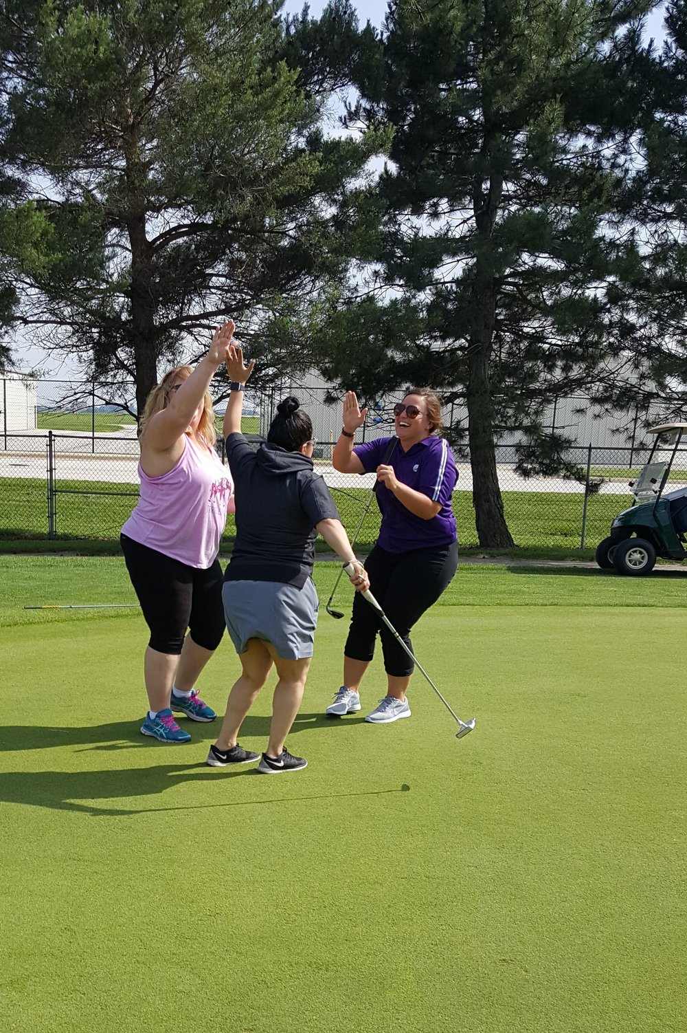 Victory - After Bernice hit the longest putt, the entire team couldn't have been more excited for her!Margy Moore (Director of Operations), Bernice Cruz (Administrative Assistant), Bernadette Sellen (Group Sales Manager)