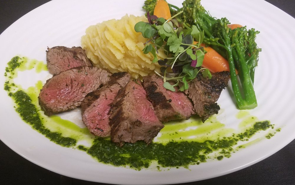 Teres Major Steak with Chimichurri Sauce off the new farm-to-fork menu at Harvest Restaurant.