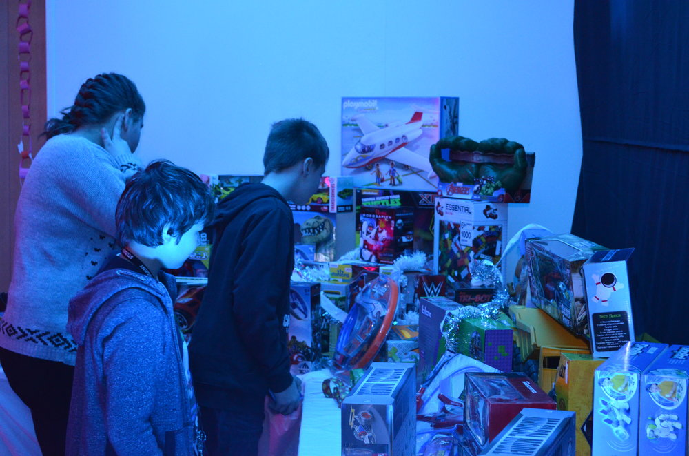 Pupils selecting their gifts.JPG