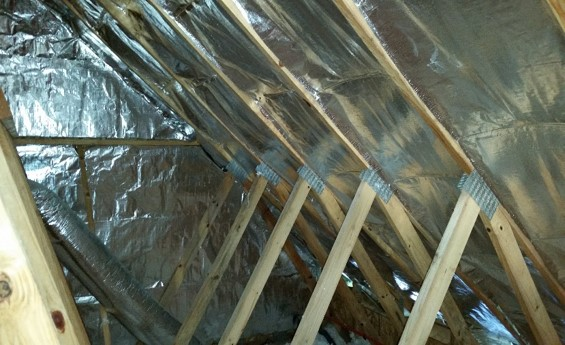 RADIANT HEAT BARRIER INSTALLED IN THE ATTIC
