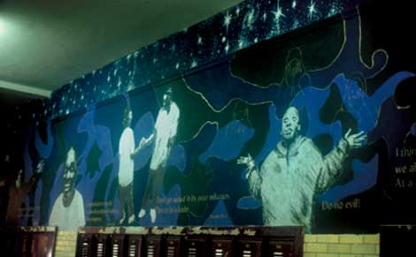 Words of Wisdom, Faces of Youth, the Elements of Unity Combined at Austin Community Academy, 2002, acrylic paint on plaster, by Tracy Van Duinen