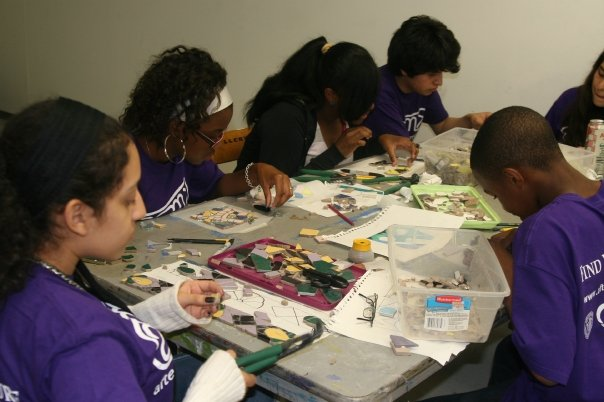 After School Matters teens work on the 57th street mosaic mural.