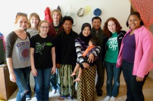 Eastern Mennonite University students visit a Karen refugee family.