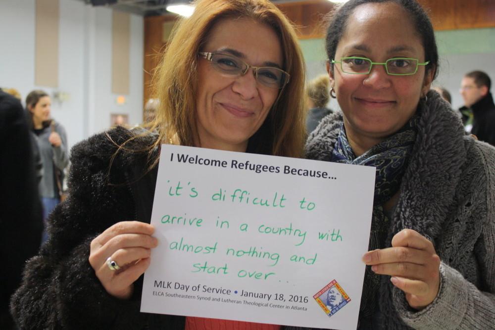 I welcome refugee sign