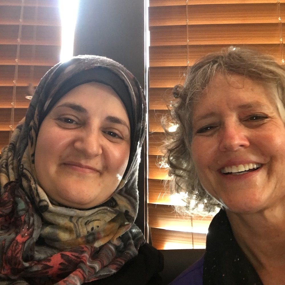 Susan and Ibtehal pose for a selfie.