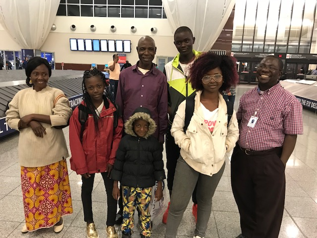 Crispin meeting a refugee family from Central African republic at the airport
