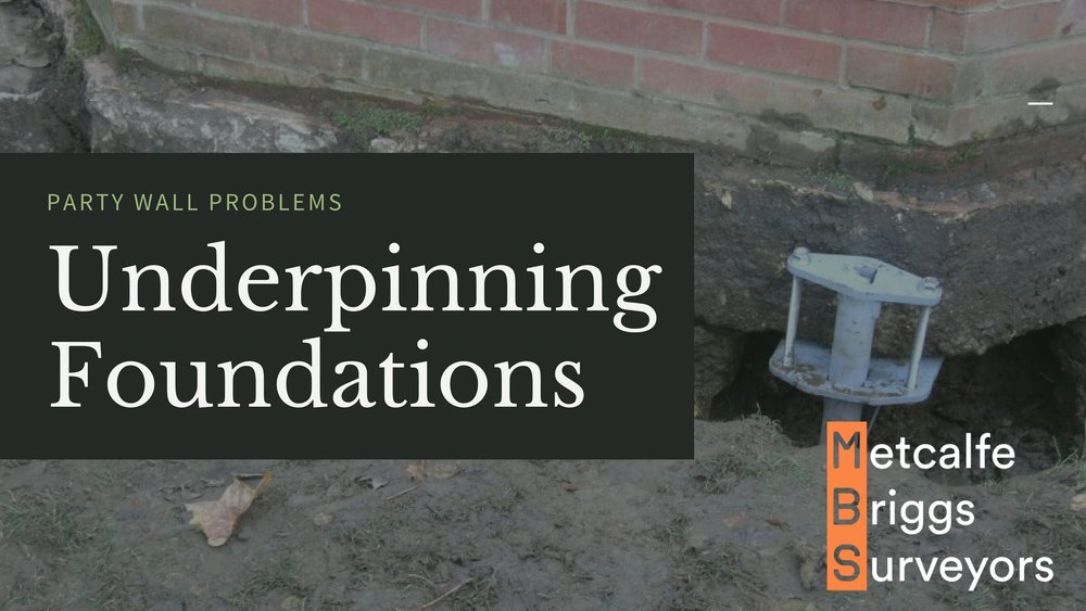 Underpinning foundations under a party wall - party wall problems.jpg